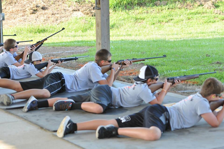 youth with rifles participating in the shooting sports tournament