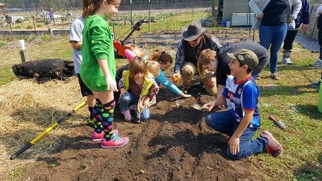 Image of kids in garden